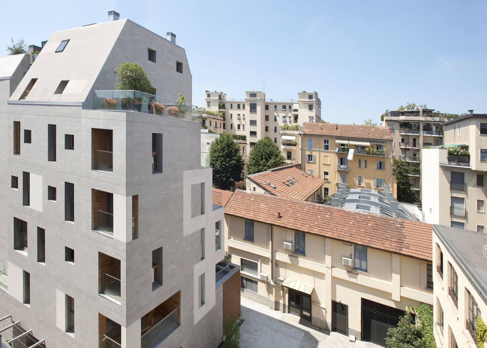 K19, case al posto di un'autorimessa degli anni '50. Demolizione e ricostruzione di LPzR